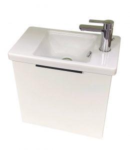 Waschbecken für Gästewc mit viel Stauraum elegant versteckt bei Zitzelsberger